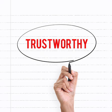 trustworthy: Hand drawing circle around the note TRUSTWORTHY, lined book page on the background Stock Photo