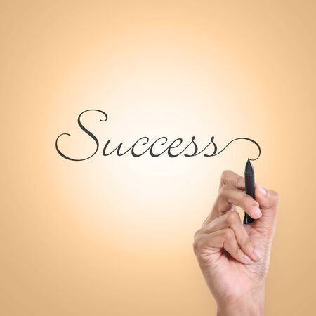 cursive: A hand writing inscription of Success in an elegant cursive lettering