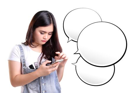bubble people: Young Asian woman reading messages on her mobile phone, with some empty chat bubbles for copy space