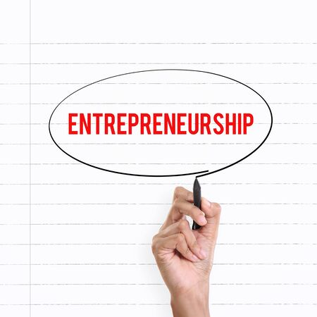 entrepreneurship: Hand drawing circle around the note ENTREPRENEURSHIP, lined book page on the background Stock Photo