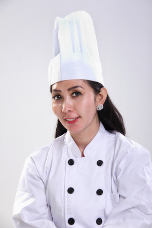 asian cook: Portrait of smiling Asian female chef over white studio background