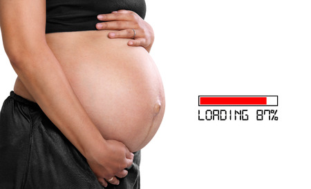 childcare: Loading 87%, baby in progress. Closeup side portrait of pregnant belly, illustration of pregnancy process Stock Photo