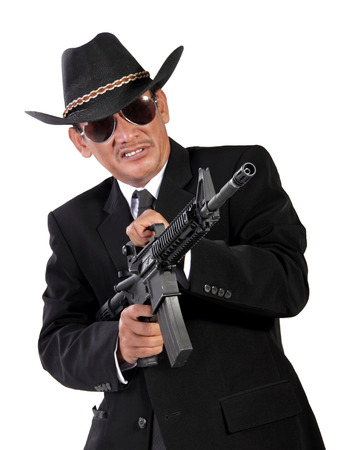 lunatic: Crazy lunatic western bandit shooting with his firearm wildly, isolated portrait on white background Stock Photo
