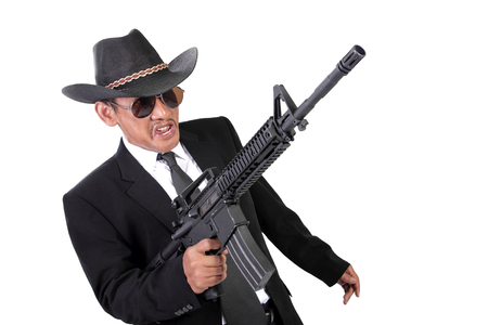 maniacal: Maniacal expression of an old gangster in a battle, with his gun pointing up, isolated on white background