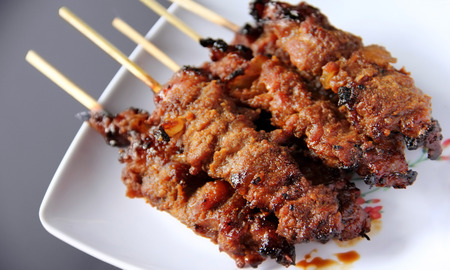 Sate Ayam is traditional kabab dish originated from Indonesia, made of seasoned and grilled chicken meat