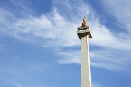 Monas or National Monument, the symbol of Jakarta city, Indonesia - over blue sky background