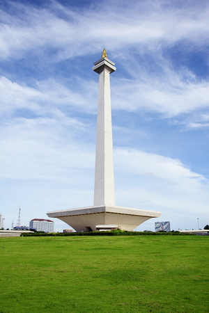 Monas, the National Monument of Jakarta, Indonesia over green grassland in the morning