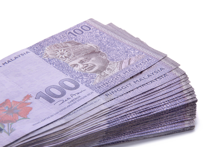 Malaysian Ringgit money in hundred nominal, stacked on white background Archivio Fotografico