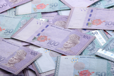 Malaysian Ringgit money in hundred and fifty nominal top view