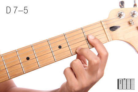D7-5 - advanced guitar keys series. Closeup of hand playing D 7-5 chord, isolated on white background Stock Photo