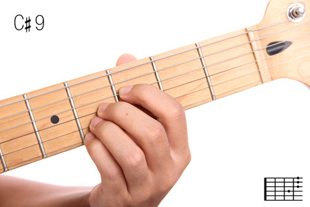 ninth: C#9 - advanced guitar keys series. Closeup of hand playing C sharp dominant ninth chord, isolated on white background Stock Photo