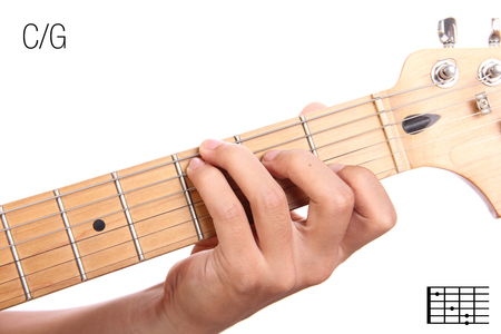 CG - guitar keys tutorial series. Closeup of hand playing C on G chord, isolated on white background Stock Photo