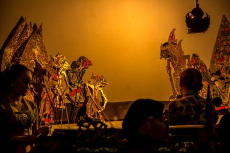 YOGYAKARTA, May 1st 2018: Dalang, the performer of wayang kulit, traditional shadow puppet art form originated from Java, Indonesia
