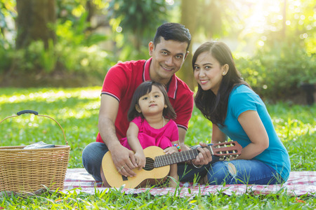 Sunday morning at a park, family portrait outdoors Standard-Bild