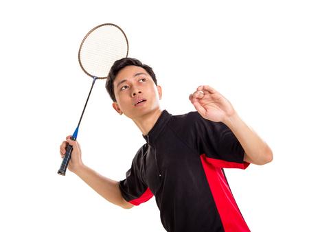 Badminton player ready to smash. Isolated on white Stock Photo