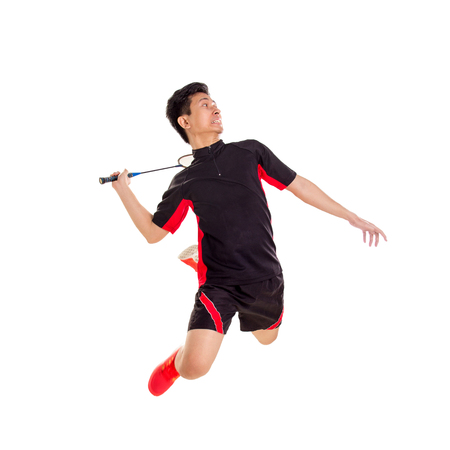 Badminton player jumping smash, isolated over white background 스톡 콘텐츠