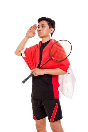 Portrait of Indonesian badminton player giving a hand salutation, isolated over white