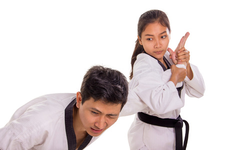 Hand submission technique practiced by a female martial artist to her male opponent. Isolated on white background 免版税图像 - 110088334