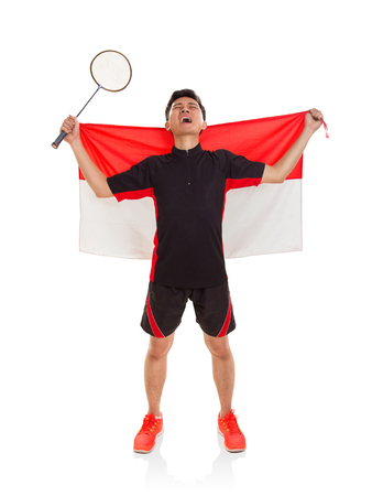 Indonesian badminton player expressing his feeling after the win. Full body portrait. Isolated background
