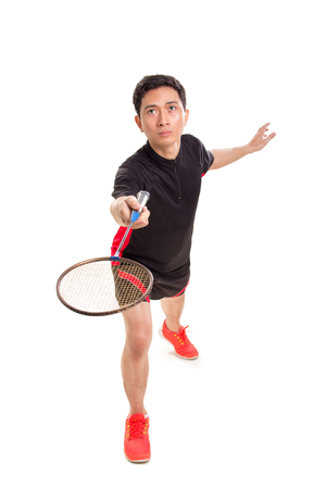 One male Asian badminton player in a match, full length portrait isolated over white Stock Photo