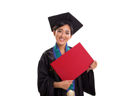 Young attractive smiling Asian female graduate student showing a certificate in her hands confidently, portrait isolated over white background 免版税图像