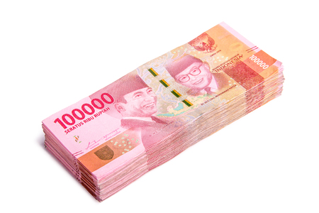 A stack of new 100.000 IDR (Indonesian Rupiah) bills, isolated on white background
