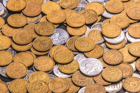 Indonesian currencies, rupiah cash in form of variate gold and silver coins 版權商用圖片