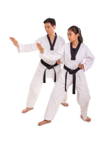 Male and female martial art practitioners performing strike move, full body portrait on white background Banco de Imagens