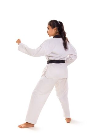 Full body profile of female tae-kwon-do fighter standing on white background, rear side view Banco de Imagens