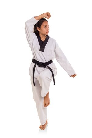 Full length shot of female tae-kwon-do athlete making a pose, isolated on white background Banco de Imagens