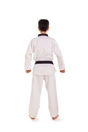 Rear view profile of a guy wearing tae-kwon-do uniform, full length shot, isolated on white background
