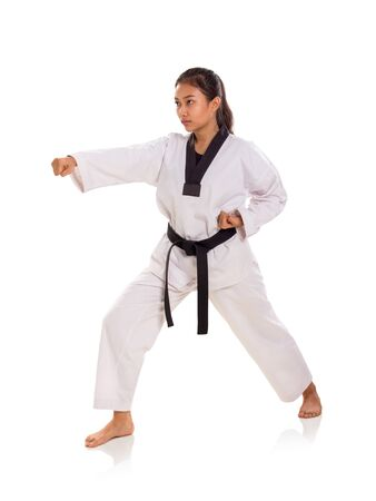 Full length shot of martial artist woman in her fighting stance, puncing with right hand, isolated on white background Banco de Imagens