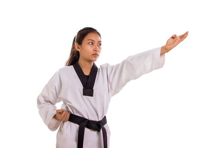 Asian female taekwondo fighter attacking with her left hand using four fingers strike technique, isolated on white background