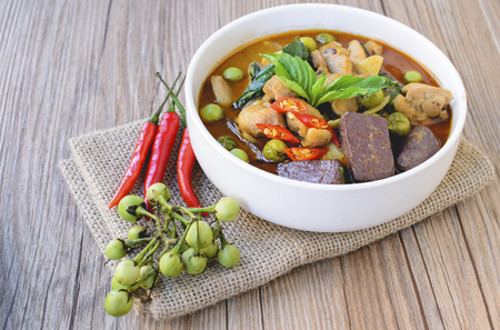traditional culture: Thai chicken green curry with old wooden background Stock Photo