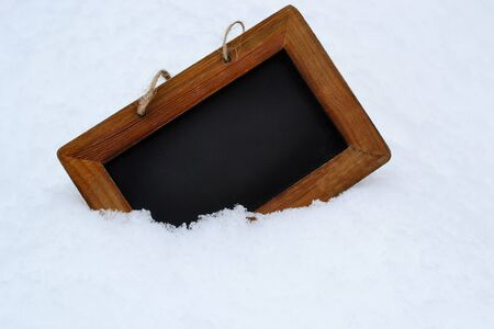 black board background with snow on winter