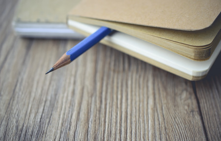 log book: blue pencil log the blank book on wooden with vintage tone