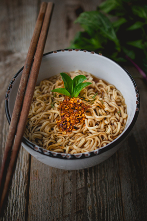 Instant Noodles in White bowl on Old Wooden, Easy Cook ,used for food ad or website promote. Food for people to work in the rush hour