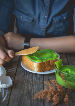 break time, coffee time with pandan custard cream on toasted, easy and ready to eat breakfast in morning with bread and custard cream topping