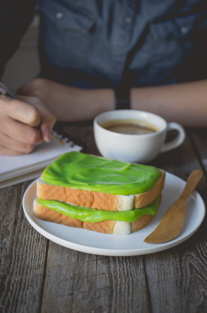 break time, coffee time with pandan custard cream on toasted, easy breakfast in morning with bread and custard cream topping