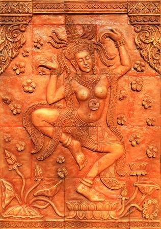 apsara: Apsara dancer carved mock Stock Photo