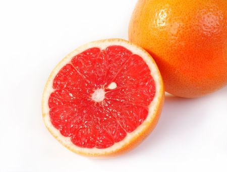 Juicy red grapefruit  on a white background.