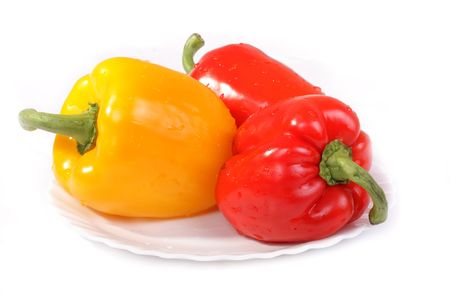 Yellow and red peppers isolated on white background