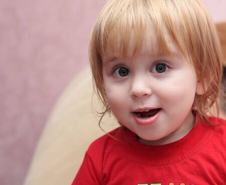 surprised the child looks in the direction