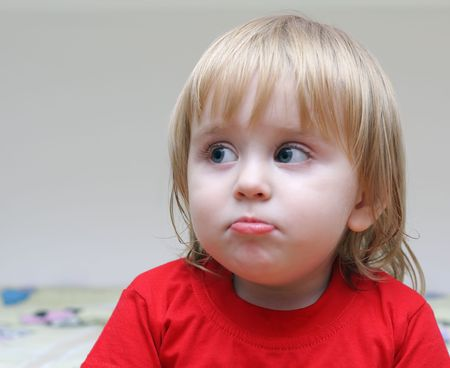 surprised child looks in the direction