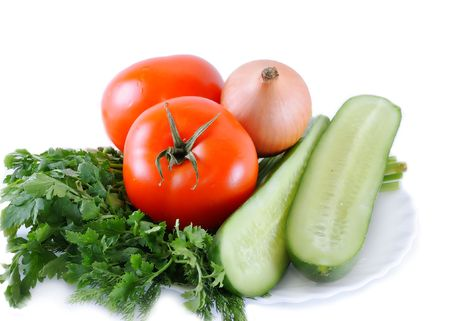 Fresh vegetables, tomatoes, cucumbers, garlic and others on a white background