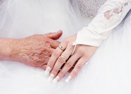 hand in hand bride and old woman Stock Photo