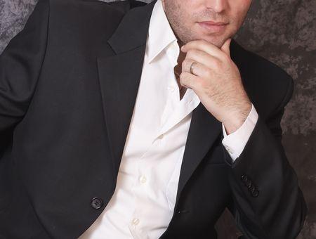 Portrait of handsome man in black costume
