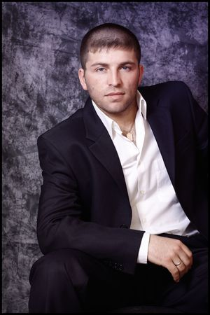 Portrait of handsome man in black costume photo