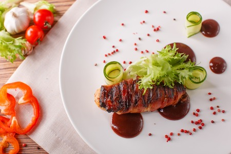 Delicious meat loaf with ketchup on a white plate, macro horizontal Stock Photo
