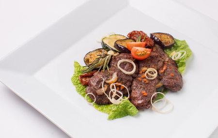 parmezan: Baked meat with zucchini and eggplant on a white background